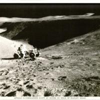 https://win-dev.lib.fit.edu/omeka/dropbox/ScottFrisch/Apollo_Photographs/Apollo-15-Commander-Scott-at-Rover-on-Edge-of-Hadley-Rille.jpg