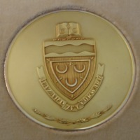 https://chell.lib.fit.edu/plugins/Dropbox/files/Medaris_Physical_Objects/Seton-Hall-Seal-Coin-Front.png